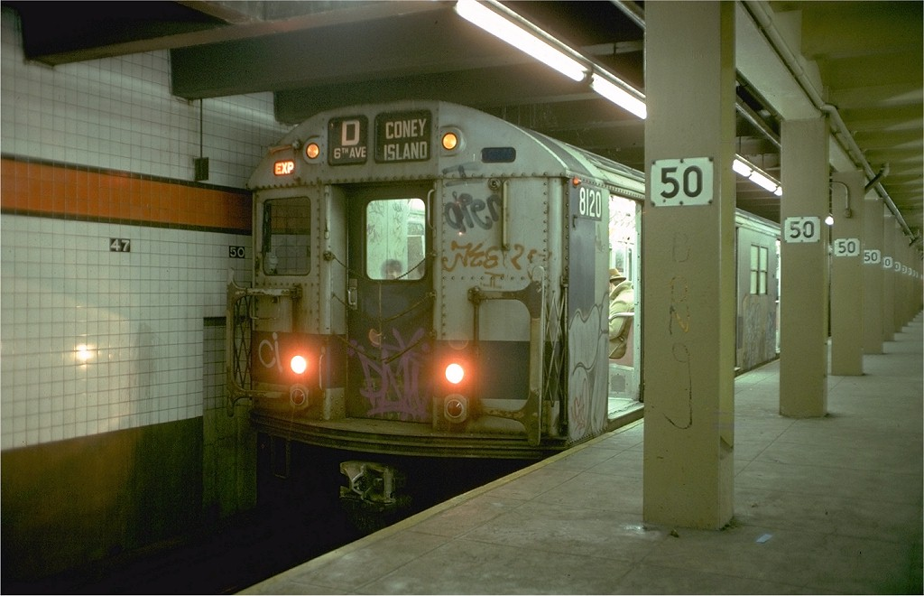 (155k, 1024x660)<br><b>Country:</b> United States<br><b>City:</b> New York<br><b>System:</b> New York City Transit<br><b>Line:</b> IND 6th Avenue Line<br><b>Location:</b> 47-50th Street/Rockefeller Center <br><b>Route:</b> D<br><b>Car:</b> R-27 (St. Louis, 1960)  8120 <br><b>Photo by:</b> Doug Grotjahn<br><b>Collection of:</b> Joe Testagrose<br><b>Date:</b> 1/28/1978<br><b>Viewed (this week/total):</b> 4 / 7093