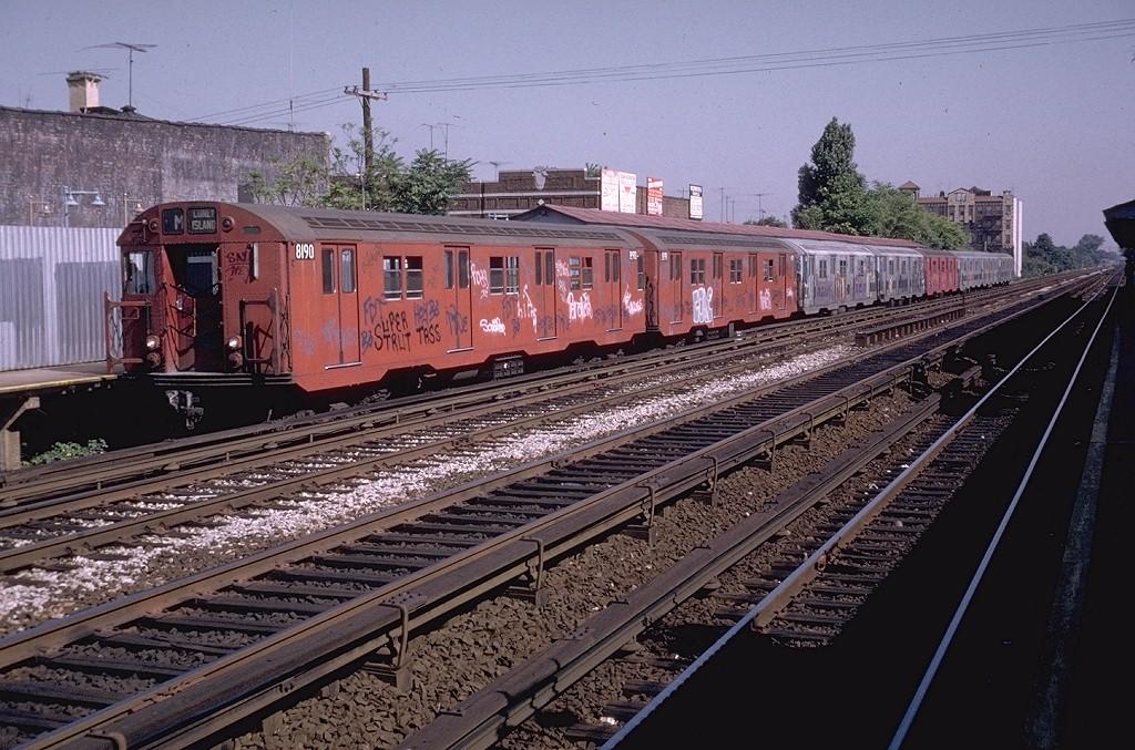 (241k, 1024x677)<br><b>Country:</b> United States<br><b>City:</b> New York<br><b>System:</b> New York City Transit<br><b>Line:</b> BMT Brighton Line<br><b>Location:</b> Avenue U <br><b>Route:</b> M<br><b>Car:</b> R-27 (St. Louis, 1960)  8190 <br><b>Photo by:</b> Doug Grotjahn<br><b>Collection of:</b> Joe Testagrose<br><b>Date:</b> 7/24/1973<br><b>Viewed (this week/total):</b> 3 / 5496