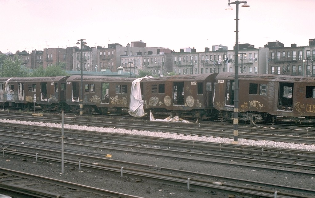(181k, 1024x644)<br><b>Country:</b> United States<br><b>City:</b> New York<br><b>System:</b> New York City Transit<br><b>Location:</b> Fresh Pond Yard<br><b>Car:</b> R-27 (St. Louis, 1960)  8202 <br><b>Photo by:</b> Joe Testagrose<br><b>Date:</b> 7/4/1976<br><b>Notes:</b> Result of a fire at Metropolitan Avenue<br><b>Viewed (this week/total):</b> 0 / 12757