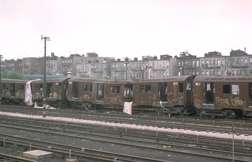 (178k, 1024x659)<br><b>Country:</b> United States<br><b>City:</b> New York<br><b>System:</b> New York City Transit<br><b>Location:</b> Fresh Pond Yard<br><b>Car:</b> R-27 (St. Louis, 1960)  8203 <br><b>Photo by:</b> Joe Testagrose<br><b>Date:</b> 7/4/1976<br><b>Notes:</b> Result of a fire at Fresh Pond station.<br><b>Viewed (this week/total):</b> 2 / 5960