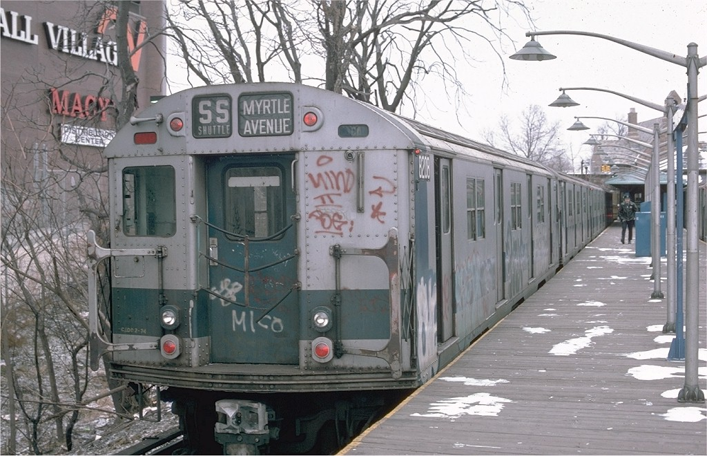 (216k, 1024x660)<br><b>Country:</b> United States<br><b>City:</b> New York<br><b>System:</b> New York City Transit<br><b>Line:</b> BMT Myrtle Avenue Line<br><b>Location:</b> Metropolitan Avenue <br><b>Route:</b> M<br><b>Car:</b> R-27 (St. Louis, 1960)  8208 <br><b>Photo by:</b> Ed McKernan<br><b>Collection of:</b> Joe Testagrose<br><b>Date:</b> 12/21/1975<br><b>Viewed (this week/total):</b> 3 / 6312