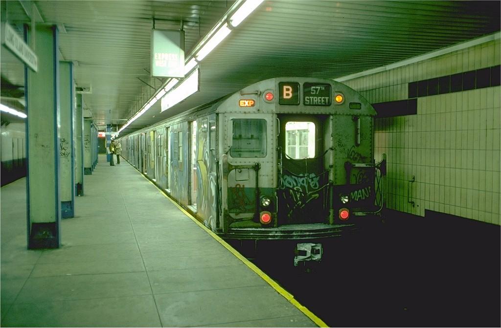 (160k, 1024x671)<br><b>Country:</b> United States<br><b>City:</b> New York<br><b>System:</b> New York City Transit<br><b>Location:</b> DeKalb Avenue<br><b>Route:</b> B<br><b>Car:</b> R-27 (St. Louis, 1960)  8209 <br><b>Photo by:</b> Doug Grotjahn<br><b>Collection of:</b> Joe Testagrose<br><b>Date:</b> 12/5/1976<br><b>Viewed (this week/total):</b> 2 / 6226