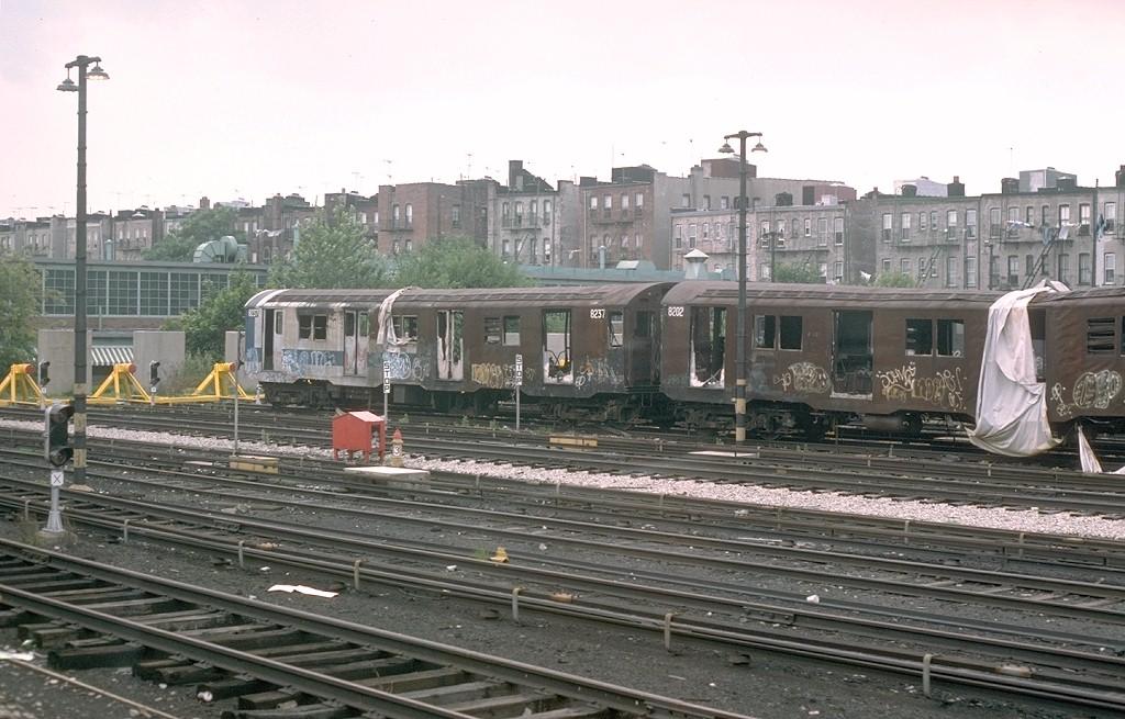 (198k, 1024x655)<br><b>Country:</b> United States<br><b>City:</b> New York<br><b>System:</b> New York City Transit<br><b>Location:</b> Fresh Pond Yard<br><b>Car:</b> R-27 (St. Louis, 1960)  8237 <br><b>Photo by:</b> Joe Testagrose<br><b>Date:</b> 7/4/1976<br><b>Notes:</b> Result of a fire at Metropolitan Avenue<br><b>Viewed (this week/total):</b> 2 / 10406