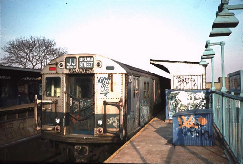 (148k, 1024x692)<br><b>Country:</b> United States<br><b>City:</b> New York<br><b>System:</b> New York City Transit<br><b>Line:</b> BMT Nassau Street/Jamaica Line<br><b>Location:</b> 75th Street/Elderts Lane <br><b>Route:</b> J<br><b>Car:</b> R-30 (St. Louis, 1961) 8254 <br><b>Photo by:</b> Joe Gorycki<br><b>Collection of:</b> Joe Testagrose<br><b>Date:</b> 3/1977<br><b>Viewed (this week/total):</b> 0 / 5857