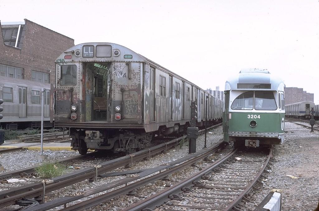 (223k, 1024x677)<br><b>Country:</b> United States<br><b>City:</b> New York<br><b>System:</b> New York City Transit<br><b>Location:</b> Coney Island Yard<br><b>Car:</b> R-30 (St. Louis, 1961) 8357 <br><b>Photo by:</b> Steve Zabel<br><b>Collection of:</b> Joe Testagrose<br><b>Date:</b> 10/13/1979<br><b>Notes:</b> With MBTA PCC 3204<br><b>Viewed (this week/total):</b> 1 / 5069