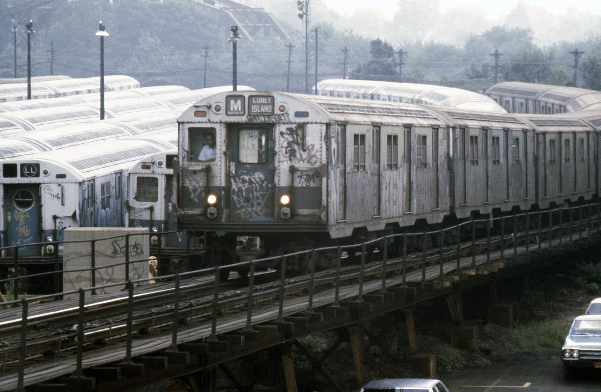 (527k, 1044x707)<br><b>Country:</b> United States<br><b>City:</b> New York<br><b>System:</b> New York City Transit<br><b>Line:</b> BMT Myrtle Avenue Line<br><b>Location:</b> Fresh Pond Road <br><b>Route:</b> M<br><b>Car:</b> R-30 (St. Louis, 1961) 8359 <br><b>Photo by:</b> Steve Hoskins<br><b>Collection of:</b> David Pirmann<br><b>Date:</b> 8/1979<br><b>Viewed (this week/total):</b> 0 / 6570