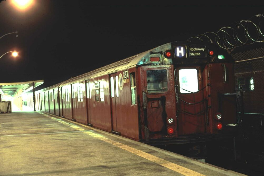 (80k, 1001x668)<br><b>Country:</b> United States<br><b>City:</b> New York<br><b>System:</b> New York City Transit<br><b>Line:</b> IND Rockaway<br><b>Location:</b> Rockaway Park/Beach 116th Street <br><b>Route:</b> H<br><b>Car:</b> R-30 (St. Louis, 1961) 8370 <br><b>Photo by:</b> Glenn L. Rowe<br><b>Date:</b> 8/17/1991<br><b>Viewed (this week/total):</b> 4 / 7544