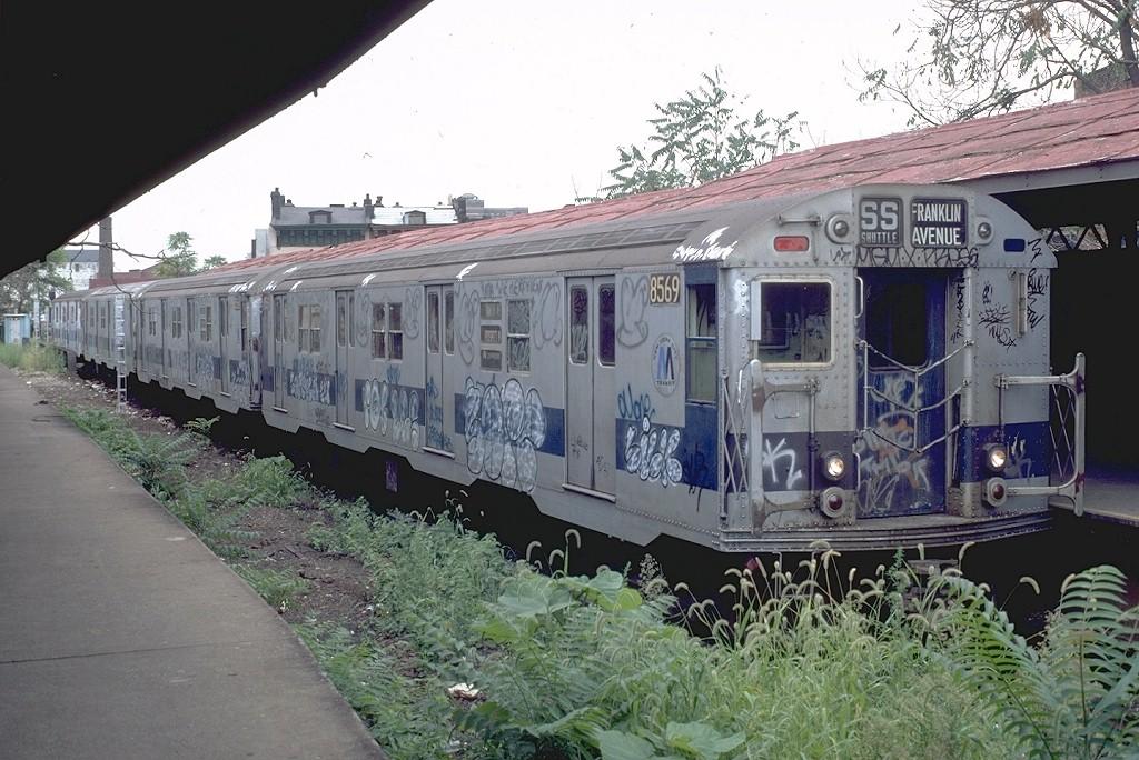 (217k, 1024x684)<br><b>Country:</b> United States<br><b>City:</b> New York<br><b>System:</b> New York City Transit<br><b>Line:</b> BMT Franklin<br><b>Location:</b> Franklin Avenue <br><b>Route:</b> Franklin Shuttle<br><b>Car:</b> R-30 (St. Louis, 1961) 8569 <br><b>Photo by:</b> Doug Grotjahn<br><b>Collection of:</b> Joe Testagrose<br><b>Date:</b> 8/22/1981<br><b>Viewed (this week/total):</b> 2 / 6116