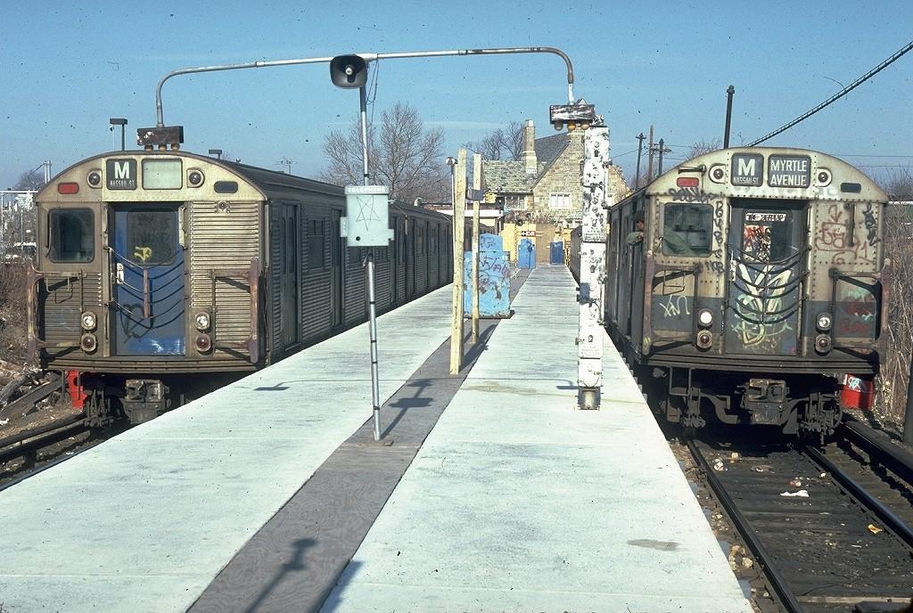 (263k, 1024x688)<br><b>Country:</b> United States<br><b>City:</b> New York<br><b>System:</b> New York City Transit<br><b>Line:</b> BMT Myrtle Avenue Line<br><b>Location:</b> Metropolitan Avenue <br><b>Route:</b> M<br><b>Car:</b> R-32 (Budd, 1964)  3838 <br><b>Photo by:</b> Doug Grotjahn<br><b>Collection of:</b> Joe Testagrose<br><b>Date:</b> 1/27/1980<br><b>Notes:</b> With R27 8398<br><b>Viewed (this week/total):</b> 2 / 8495
