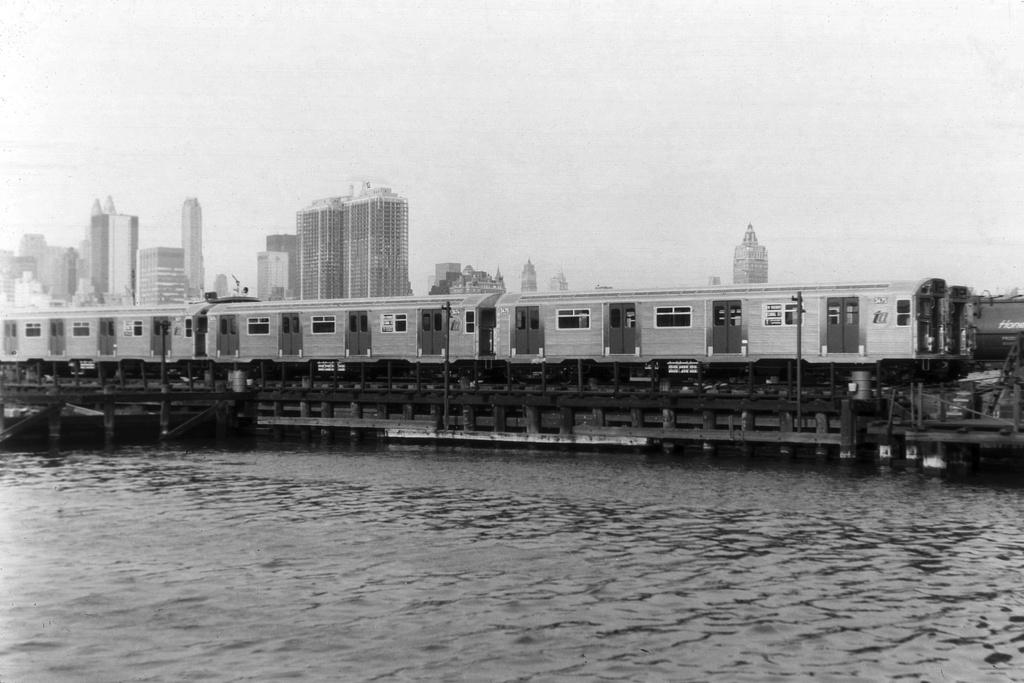 (232k, 1024x683)<br><b>Country:</b> United States<br><b>City:</b> New York<br><b>System:</b> Long Island Rail Road<br><b>Line:</b> LIRR Long Island City<br><b>Location:</b> Long Island City <br><b>Car:</b> R-32 (Budd, 1964)  3475 <br><b>Collection of:</b> David Pirmann<br><b>Notes:</b> Being delivered by carfloat<br><b>Viewed (this week/total):</b> 0 / 4920