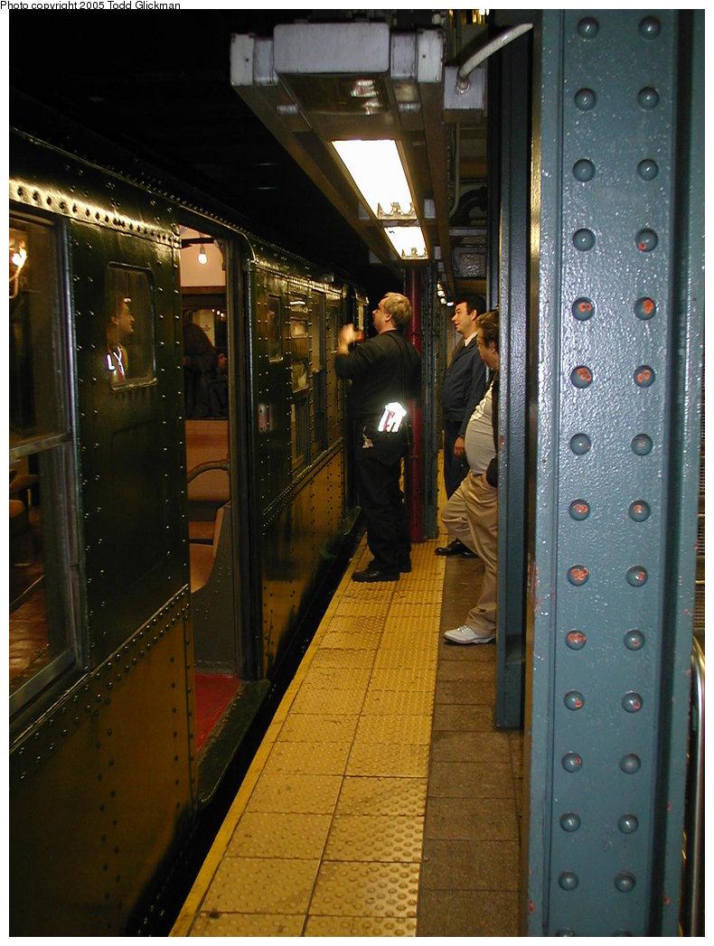 (186k, 790x1047)<br><b>Country:</b> United States<br><b>City:</b> New York<br><b>System:</b> New York City Transit<br><b>Line:</b> BMT Broadway Line<br><b>Location:</b> Whitehall Street <br><b>Route:</b> Fan Trip<br><b>Car:</b> R-1 (American Car & Foundry, 1930-1931) 100 <br><b>Photo by:</b> Todd Glickman<br><b>Date:</b> 11/27/2004<br><b>Notes:</b> Train in regular passenger service for the holidays, not techically a fan trip.<br><b>Viewed (this week/total):</b> 1 / 3368