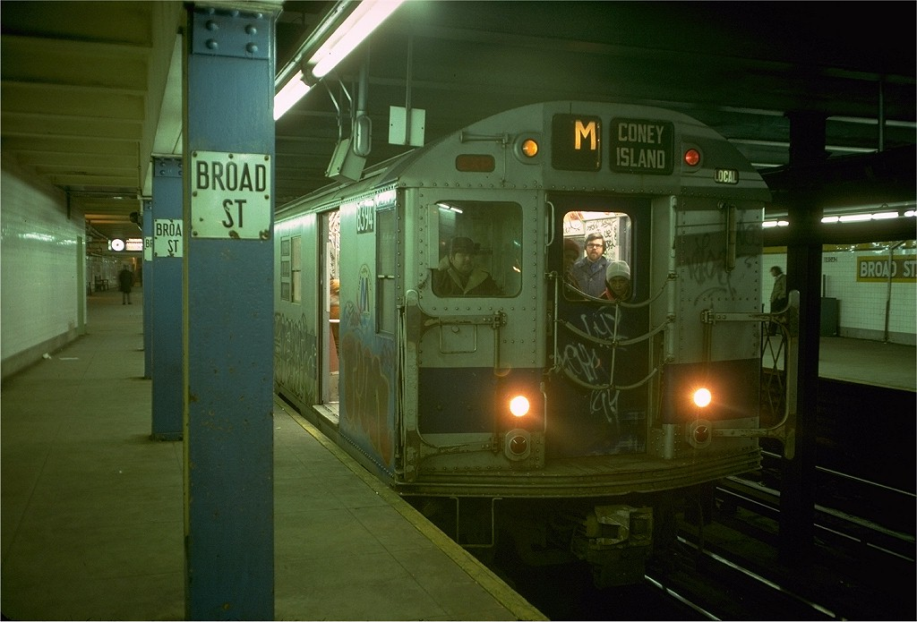 (161k, 1024x695)<br><b>Country:</b> United States<br><b>City:</b> New York<br><b>System:</b> New York City Transit<br><b>Line:</b> BMT Nassau Street/Jamaica Line<br><b>Location:</b> Broad Street <br><b>Route:</b> M<br><b>Car:</b> R-30 (St. Louis, 1961) 8394 <br><b>Photo by:</b> Doug Grotjahn<br><b>Collection of:</b> Joe Testagrose<br><b>Date:</b> 12/30/1976<br><b>Viewed (this week/total):</b> 3 / 6966