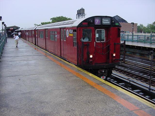 (61k, 640x480)<br><b>Country:</b> United States<br><b>City:</b> New York<br><b>System:</b> New York City Transit<br><b>Line:</b> IRT Flushing Line<br><b>Location:</b> 103rd Street/Corona Plaza <br><b>Route:</b> 7<br><b>Car:</b> R-36 World's Fair (St. Louis, 1963-64) 9749 <br><b>Photo by:</b> Salaam Allah<br><b>Date:</b> 9/26/2002<br><b>Viewed (this week/total):</b> 0 / 2687