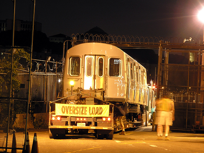 (508k, 700x525)<br><b>Country:</b> United States<br><b>City:</b> New York<br><b>System:</b> New York City Transit<br><b>Location:</b> 207th Street Yard<br><b>Car:</b> R-160B (Kawasaki, 2005-2008)  8713 <br><b>Photo by:</b> Trevor Logan<br><b>Date:</b> 7/20/2005<br><b>Notes:</b> First R160 being delivered. Photo courtesy TransiTalk Media Group.<br><b>Viewed (this week/total):</b> 3 / 11004