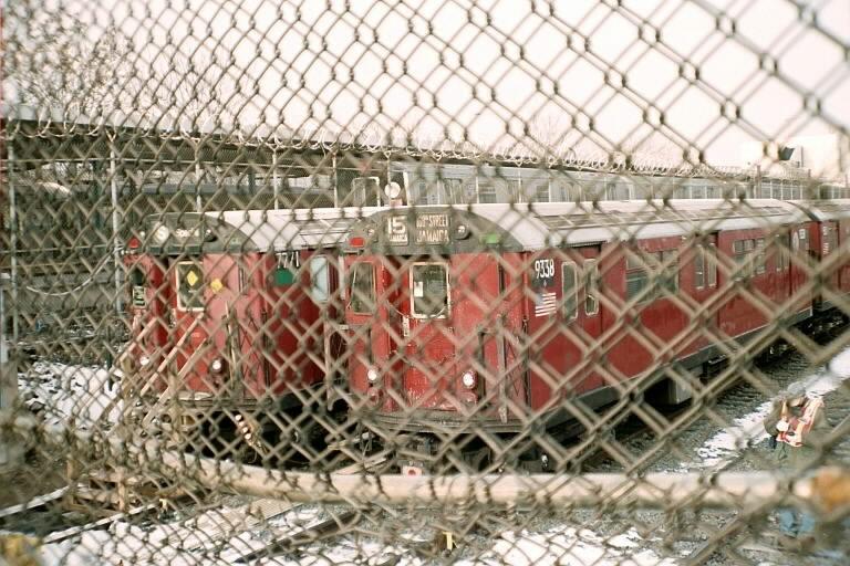 (110k, 768x512)<br><b>Country:</b> United States<br><b>City:</b> New York<br><b>System:</b> New York City Transit<br><b>Location:</b> Rockaway Parkway (Canarsie) Yard<br><b>Route:</b> Fan Trip<br><b>Car:</b> R-33 World's Fair (St. Louis, 1963-64) 9338 <br><b>Photo by:</b> Michael Pompili<br><b>Date:</b> 12/8/2002<br><b>Notes:</b> With 7771<br><b>Viewed (this week/total):</b> 1 / 2459