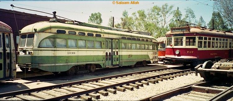 (232k, 750x326)<br><b>Country:</b> United States<br><b>City:</b> Perris, CA<br><b>System:</b> Orange Empire Railway Museum <br><b>Car:</b> SF MUNI PCC Baby Ten (St. Louis Car Co, 1951)  1039 <br><b>Photo by:</b> Salaam Allah<br><b>Date:</b> 1/18/1999<br><b>Viewed (this week/total):</b> 3 / 2755