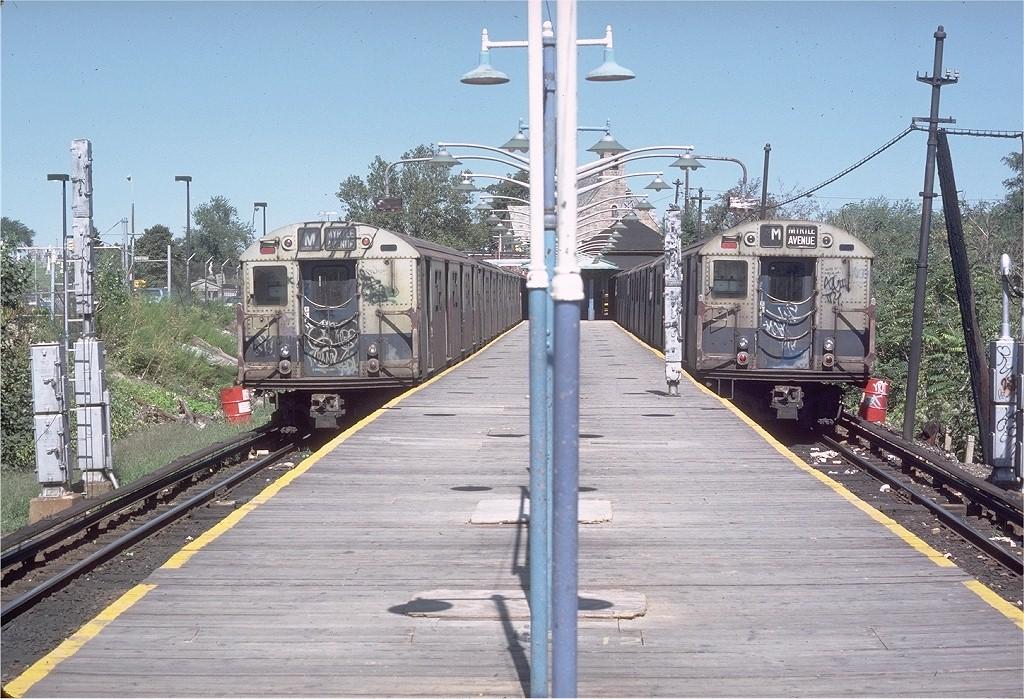 (254k, 1024x699)<br><b>Country:</b> United States<br><b>City:</b> New York<br><b>System:</b> New York City Transit<br><b>Line:</b> BMT Myrtle Avenue Line<br><b>Location:</b> Metropolitan Avenue <br><b>Route:</b> M<br><b>Car:</b> R-30 (St. Louis, 1961) 8394 <br><b>Photo by:</b> Doug Grotjahn<br><b>Collection of:</b> Joe Testagrose<br><b>Date:</b> 9/9/1979<br><b>Viewed (this week/total):</b> 0 / 4140
