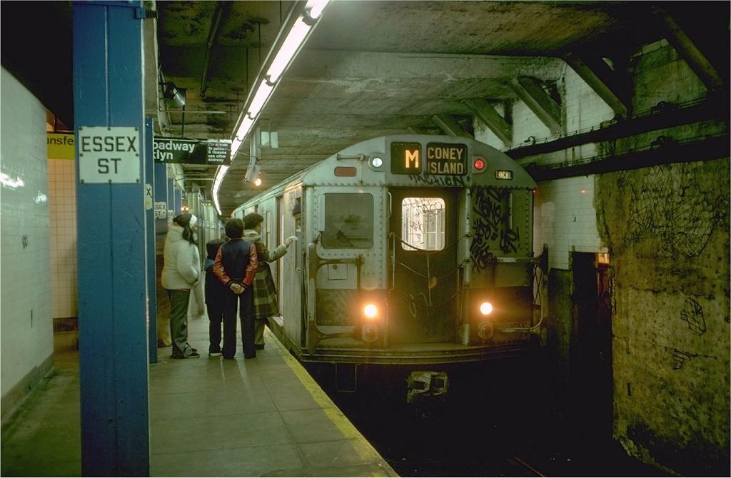 (176k, 1024x670)<br><b>Country:</b> United States<br><b>City:</b> New York<br><b>System:</b> New York City Transit<br><b>Line:</b> BMT Nassau Street/Jamaica Line<br><b>Location:</b> Essex Street <br><b>Route:</b> M<br><b>Car:</b> R-30 (St. Louis, 1961) 8426 <br><b>Photo by:</b> Doug Grotjahn<br><b>Collection of:</b> Joe Testagrose<br><b>Date:</b> 12/31/1976<br><b>Viewed (this week/total):</b> 5 / 5152