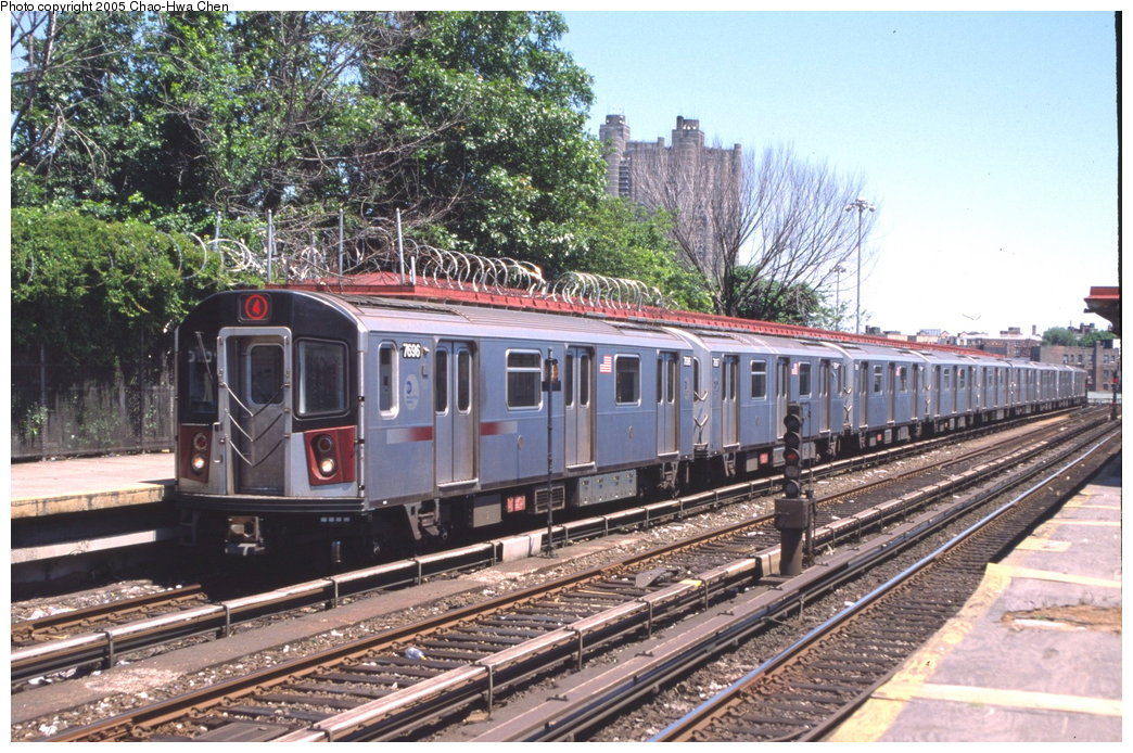 (230k, 1044x694)<br><b>Country:</b> United States<br><b>City:</b> New York<br><b>System:</b> New York City Transit<br><b>Line:</b> IRT Woodlawn Line<br><b>Location:</b> Bedford Park Boulevard <br><b>Route:</b> 4<br><b>Car:</b> R-142A (Option Order, Kawasaki, 2002-2003)  7696 <br><b>Photo by:</b> Chao-Hwa Chen<br><b>Date:</b> 7/1/2003<br><b>Viewed (this week/total):</b> 0 / 3685