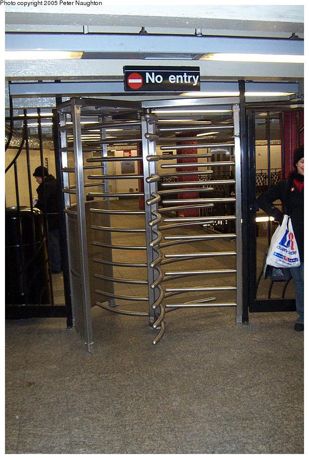 (192k, 620x920)<br><b>Country:</b> United States<br><b>City:</b> New York<br><b>System:</b> New York City Transit<br><b>Line:</b> IND 8th Avenue Line<br><b>Location:</b> 207th Street <br><b>Photo by:</b> Peter Naughton<br><b>Date:</b> 2/15/2005<br><b>Notes:</b> Modern exit-only turnstile<br><b>Viewed (this week/total):</b> 0 / 2258