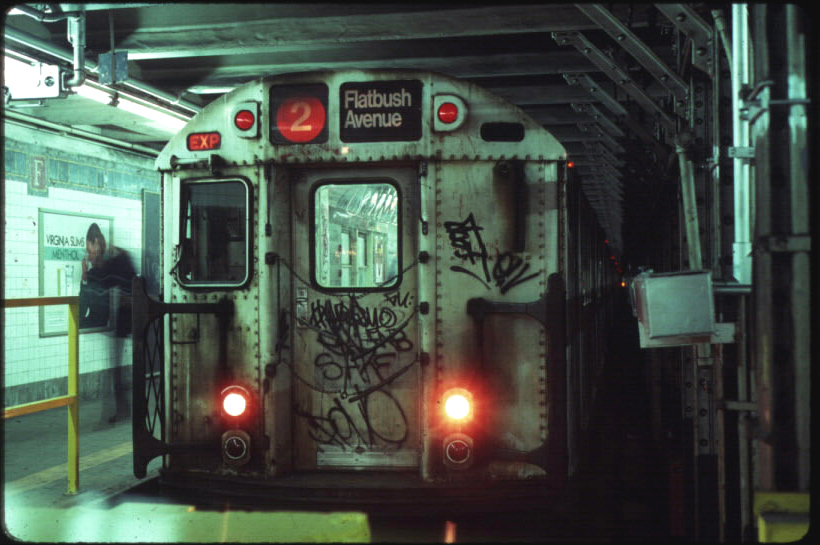 (306k, 820x545)<br><b>Country:</b> United States<br><b>City:</b> New York<br><b>System:</b> New York City Transit<br><b>Line:</b> IRT Brooklyn Line<br><b>Location:</b> Flatbush Avenue <br><b>Route:</b> 2<br><b>Car:</b> R-28 (American Car & Foundry, 1960-61) 7938 <br><b>Photo by:</b> Eric Oszustowicz<br><b>Collection of:</b> Michael Pompili<br><b>Date:</b> 12/2/1986<br><b>Viewed (this week/total):</b> 0 / 9122