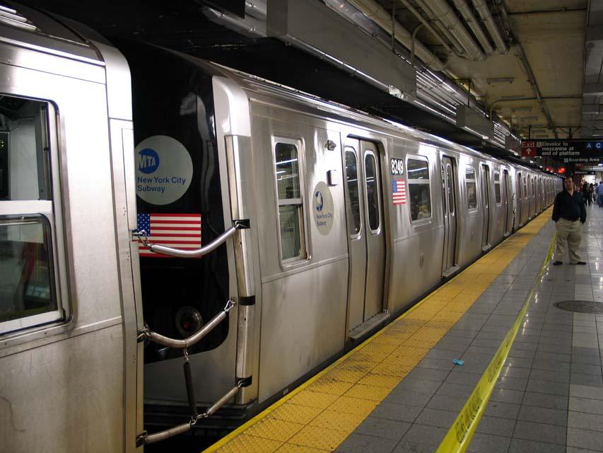(94k, 853x640)<br><b>Country:</b> United States<br><b>City:</b> New York<br><b>System:</b> New York City Transit<br><b>Line:</b> BMT Canarsie Line<br><b>Location:</b> 8th Avenue <br><b>Route:</b> L<br><b>Car:</b> R-143 (Kawasaki, 2001-2002) 8249 <br><b>Photo by:</b> Michael Pompili<br><b>Date:</b> 4/18/2004<br><b>Viewed (this week/total):</b> 0 / 3286