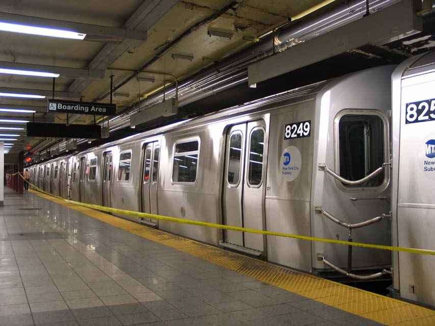 (93k, 853x640)<br><b>Country:</b> United States<br><b>City:</b> New York<br><b>System:</b> New York City Transit<br><b>Line:</b> BMT Canarsie Line<br><b>Location:</b> 8th Avenue <br><b>Route:</b> L<br><b>Car:</b> R-143 (Kawasaki, 2001-2002) 8249 <br><b>Photo by:</b> Michael Pompili<br><b>Date:</b> 4/18/2004<br><b>Viewed (this week/total):</b> 1 / 3592