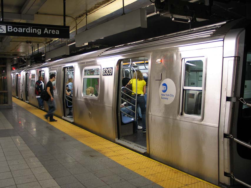 (93k, 853x640)<br><b>Country:</b> United States<br><b>City:</b> New York<br><b>System:</b> New York City Transit<br><b>Line:</b> BMT Canarsie Line<br><b>Location:</b> 8th Avenue <br><b>Route:</b> L<br><b>Car:</b> R-143 (Kawasaki, 2001-2002) 8309 <br><b>Photo by:</b> Michael Pompili<br><b>Date:</b> 4/18/2004<br><b>Viewed (this week/total):</b> 1 / 4561