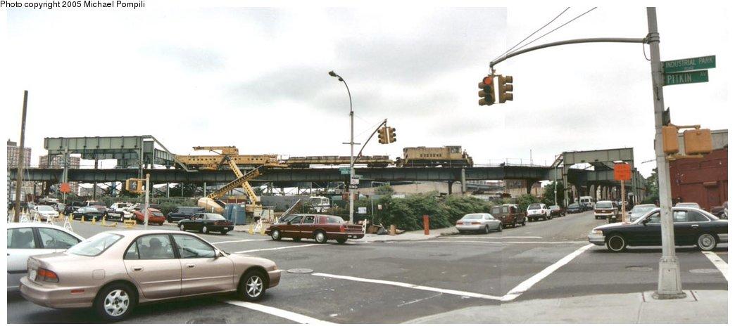 (96k, 1044x471)<br><b>Country:</b> United States<br><b>City:</b> New York<br><b>System:</b> New York City Transit<br><b>Line:</b> BMT Canarsie Line<br><b>Location:</b> Snediker Avenue <br><b>Car:</b> R-77 Locomotive  890 <br><b>Photo by:</b> Michael Pompili<br><b>Date:</b> 2003<br><b>Viewed (this week/total):</b> 5 / 4037
