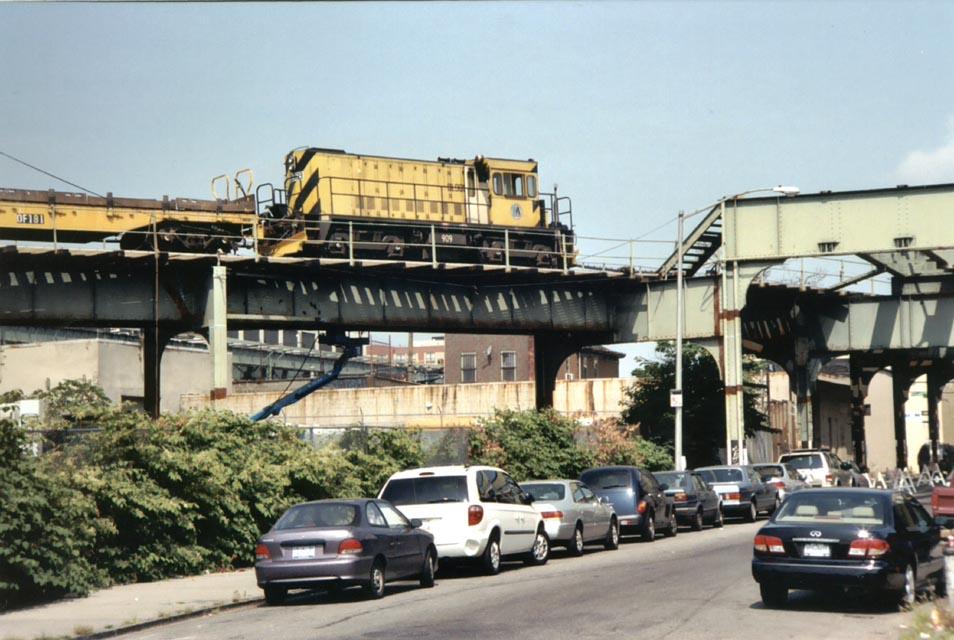 (123k, 954x640)<br><b>Country:</b> United States<br><b>City:</b> New York<br><b>System:</b> New York City Transit<br><b>Line:</b> BMT Canarsie Line<br><b>Location:</b> Snediker Avenue <br><b>Car:</b> R-120 Locomotive  909 <br><b>Photo by:</b> Michael Pompili<br><b>Date:</b> 2003<br><b>Viewed (this week/total):</b> 0 / 3050