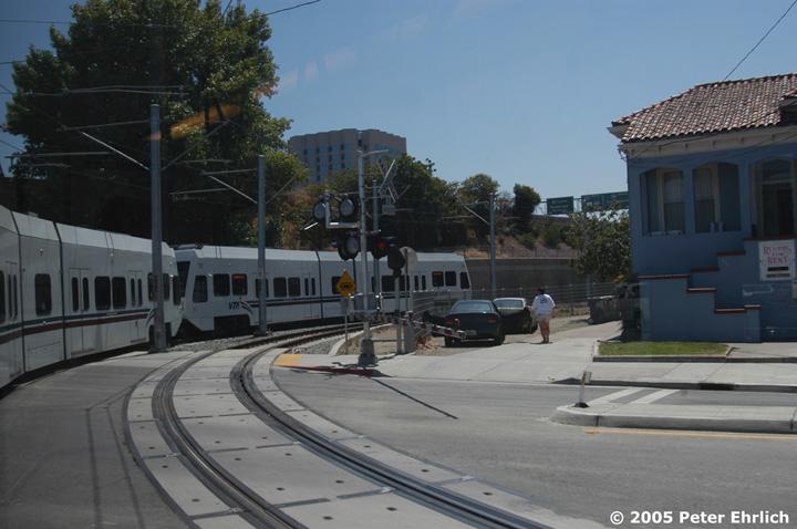 (120k, 720x478)<br><b>Country:</b> United States<br><b>City:</b> San Jose, CA<br><b>System:</b> Santa Clara VTA<br><b>Line:</b> VTA Vasona Line<br><b>Location:</b> San Fernando <br><b>Car:</b> VTA Kinki-Sharyo 932 <br><b>Photo by:</b> Peter Ehrlich<br><b>Date:</b> 7/30/2005<br><b>Notes:</b> View of the last car of a 3-car train crossing San Fernando Street approaching San Fernando Station outbound.<br><b>Viewed (this week/total):</b> 0 / 1675