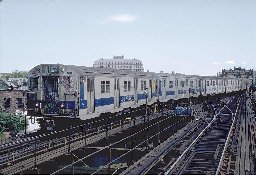 (240k, 1024x699)<br><b>Country:</b> United States<br><b>City:</b> New York<br><b>System:</b> New York City Transit<br><b>Line:</b> BMT Nassau Street/Jamaica Line<br><b>Location:</b> Queens Boulevard (Demolished) <br><b>Route:</b> J<br><b>Car:</b> R-27 (St. Louis, 1960)  8123 <br><b>Photo by:</b> Steve Zabel<br><b>Collection of:</b> Joe Testagrose<br><b>Date:</b> 8/18/1982<br><b>Viewed (this week/total):</b> 1 / 5922