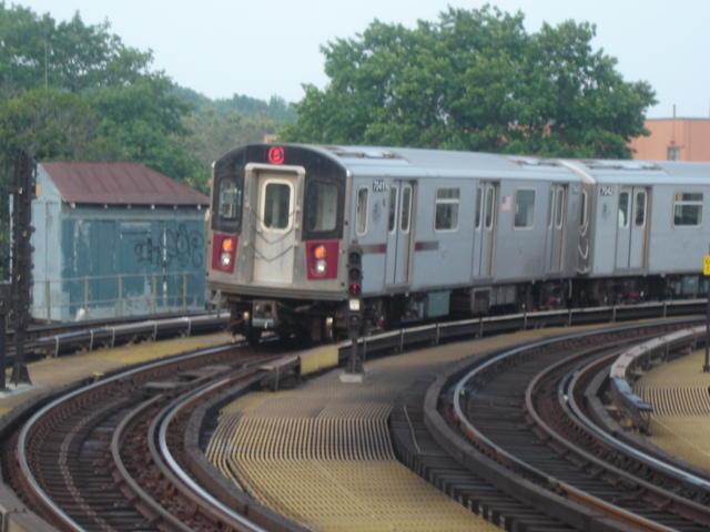 (52k, 640x480)<br><b>Country:</b> United States<br><b>City:</b> New York<br><b>System:</b> New York City Transit<br><b>Line:</b> IRT White Plains Road Line<br><b>Location:</b> West Farms Sq./East Tremont Ave./177th St. <br><b>Route:</b> 5<br><b>Car:</b> R-142 (Option Order, Bombardier, 2002-2003)  7041 <br><b>Photo by:</b> DeAndre Burrell<br><b>Date:</b> 8/12/2005<br><b>Viewed (this week/total):</b> 0 / 4061