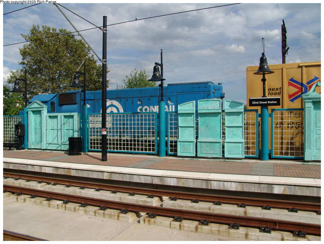 (222k, 1044x788)<br><b>Country:</b> United States<br><b>City:</b> Bayonne, NJ<br><b>System:</b> Hudson Bergen Light Rail<br><b>Location:</b> East 22nd Street <br><b>Photo by:</b> Richard Panse<br><b>Date:</b> 8/26/2005<br><b>Notes:</b> Platform art with Conrail train.<br><b>Viewed (this week/total):</b> 1 / 2364