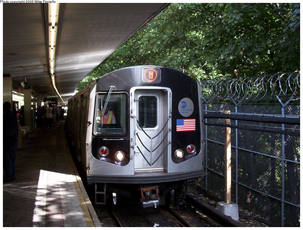 (221k, 1044x793)<br><b>Country:</b> United States<br><b>City:</b> New York<br><b>System:</b> New York City Transit<br><b>Line:</b> BMT Myrtle Avenue Line<br><b>Location:</b> Metropolitan Avenue <br><b>Route:</b> M<br><b>Car:</b> R-143 (Kawasaki, 2001-2002)  <br><b>Photo by:</b> Mike Fioriello<br><b>Date:</b> 9/27/2003<br><b>Viewed (this week/total):</b> 4 / 4721