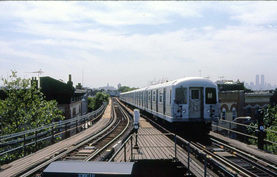 (101k, 919x588)<br><b>Country:</b> United States<br><b>City:</b> New York<br><b>System:</b> New York City Transit<br><b>Line:</b> BMT Myrtle Avenue Line<br><b>Location:</b> Forest Avenue <br><b>Route:</b> M<br><b>Car:</b> R-42 (St. Louis, 1969-1970)   <br><b>Photo by:</b> Christopher Sattler<br><b>Date:</b> 6/16/1994<br><b>Viewed (this week/total):</b> 2 / 11875