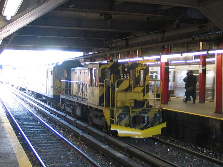 (102k, 853x640)<br><b>Country:</b> United States<br><b>City:</b> New York<br><b>System:</b> New York City Transit<br><b>Line:</b> BMT Brighton Line<br><b>Location:</b> Newkirk Plaza (fmrly Newkirk Ave.) <br><b>Route:</b> Work Service<br><b>Car:</b> R-77 Locomotive  893 <br><b>Photo by:</b> Michael Pompili<br><b>Date:</b> 12/8/2004<br><b>Viewed (this week/total):</b> 1 / 2681