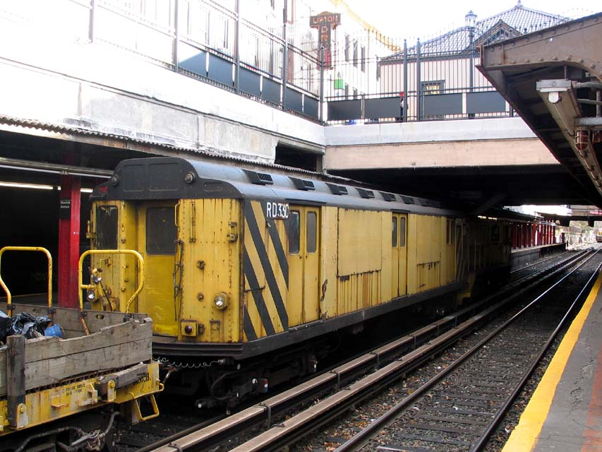 (122k, 853x640)<br><b>Country:</b> United States<br><b>City:</b> New York<br><b>System:</b> New York City Transit<br><b>Line:</b> BMT Brighton Line<br><b>Location:</b> Newkirk Plaza (fmrly Newkirk Ave.) <br><b>Route:</b> Work Service<br><b>Car:</b> R-71 Rider Car (R-17/R-21/R-22 Rebuilds)  RD330 (ex-5857)<br><b>Photo by:</b> Michael Pompili<br><b>Date:</b> 12/8/2004<br><b>Viewed (this week/total):</b> 0 / 3202