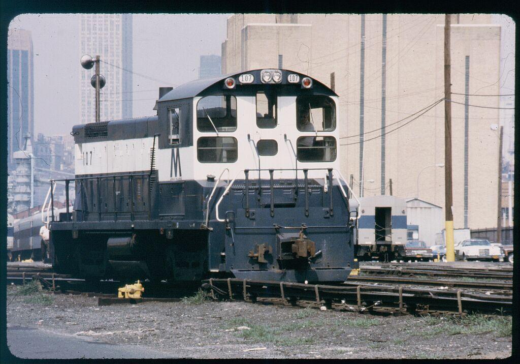 (134k, 1024x716)<br><b>Country:</b> United States<br><b>City:</b> New York<br><b>System:</b> Long Island Rail Road<br><b>Line:</b> LIRR Long Island City<br><b>Location:</b> Long Island City <br><b>Car:</b> LIRR SW1001 (Diesel) 107 <br><b>Photo by:</b> Steve Hoskins<br><b>Notes:</b> 1970s<br><b>Viewed (this week/total):</b> 0 / 1216