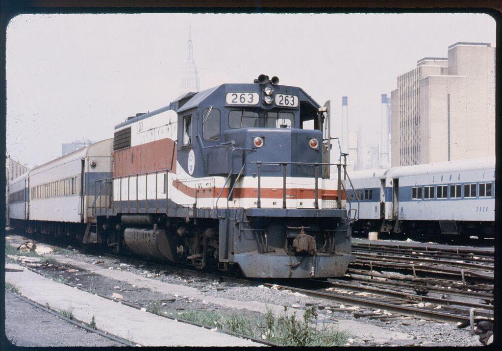 (129k, 1024x716)<br><b>Country:</b> United States<br><b>City:</b> New York<br><b>System:</b> Long Island Rail Road<br><b>Line:</b> LIRR Long Island City<br><b>Location:</b> Long Island City <br><b>Car:</b> LIRR GP38-2 (Diesel) 263 <br><b>Photo by:</b> Steve Hoskins<br><b>Notes:</b> 1970s<br><b>Viewed (this week/total):</b> 1 / 1279