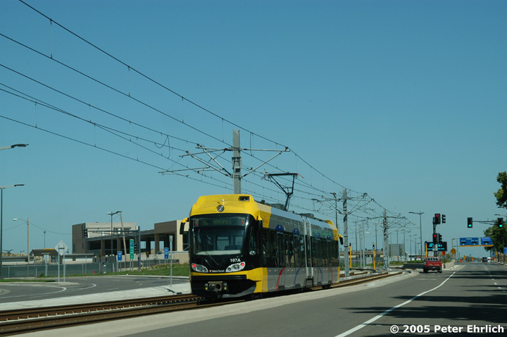 (106k, 720x478)<br><b>Country:</b> United States<br><b>City:</b> Minneapolis, MN<br><b>System:</b> MNDOT Light Rail Transit<br><b>Line:</b> Hiawatha Line<br><b>Location:</b> 34th Avenue/nr. Ft. Snelling National Cem. <br><b>Car:</b> Bombardier Flexity Swift  107 <br><b>Photo by:</b> Peter Ehrlich<br><b>Date:</b> 8/28/2005<br><b>Notes:</b> Car 107 heading inbound along 34th Avenue. The Ft. Snelling National Cemetery is out of the picture on the right.<br><b>Viewed (this week/total):</b> 1 / 1339