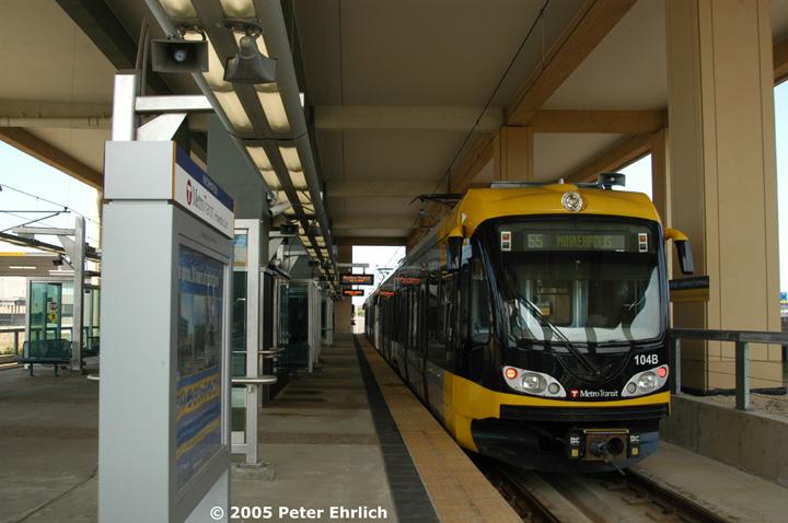 (127k, 720x478)<br><b>Country:</b> United States<br><b>City:</b> Minneapolis, MN<br><b>System:</b> MNDOT Light Rail Transit<br><b>Line:</b> Hiawatha Line<br><b>Location:</b> <b><u>Airport-Humphrey Terminal </b></u><br><b>Car:</b> Bombardier Flexity Swift  104+115 <br><b>Photo by:</b> Peter Ehrlich<br><b>Date:</b> 9/4/2005<br><b>Notes:</b> Inbound train at Humphrey Terminal Station.  Charter flights operate from this terminal.<br><b>Viewed (this week/total):</b> 0 / 1586