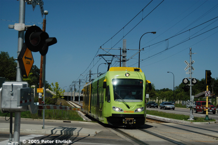 (133k, 720x478)<br><b>Country:</b> United States<br><b>City:</b> Minneapolis, MN<br><b>System:</b> MNDOT Light Rail Transit<br><b>Line:</b> Hiawatha Line<br><b>Location:</b> <b><u>50th Street/Minnehaha Park </b></u><br><b>Car:</b> Bombardier Flexity Swift  116 <br><b>Photo by:</b> Peter Ehrlich<br><b>Date:</b> 8/27/2005<br><b>Notes:</b> iPod-wrapped train approaching 50th Street/Minnehaha Park Station outbound.<br><b>Viewed (this week/total):</b> 1 / 1507