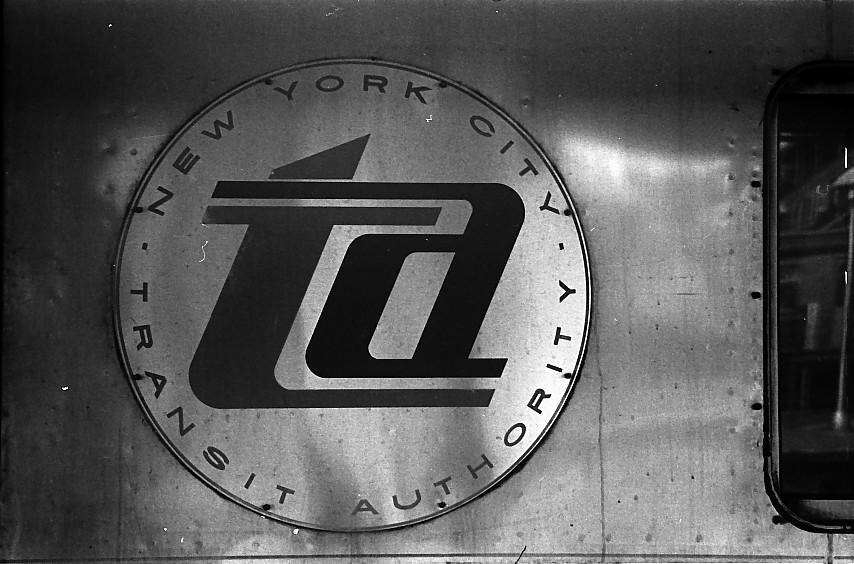 (132k, 854x564)<br><b>Country:</b> United States<br><b>City:</b> New York<br><b>System:</b> New York City Transit<br><b>Location:</b> Coney Island/Stillwell Avenue<br><b>Photo by:</b> Stuart Gitlow<br><b>Date:</b> 10/1977<br><b>Notes:</b> TA Logo on train.<br><b>Viewed (this week/total):</b> 0 / 1424