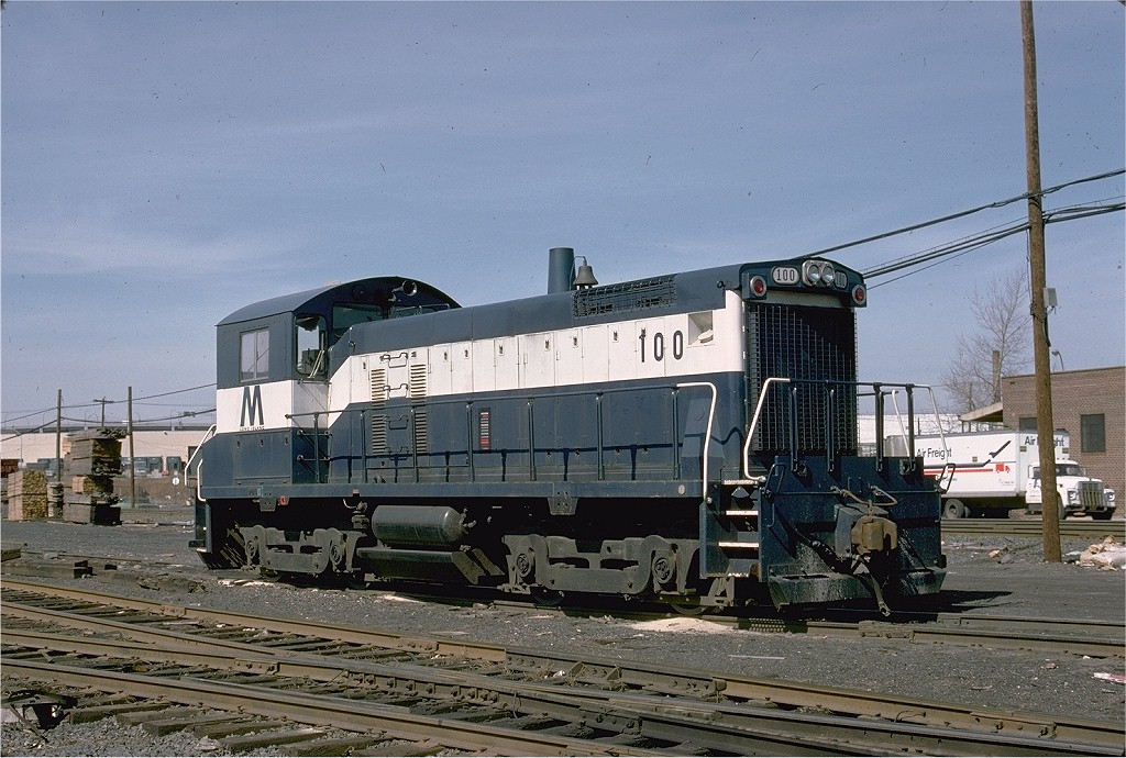 (221k, 1024x690)<br><b>Country:</b> United States<br><b>City:</b> New York<br><b>System:</b> Long Island Rail Road<br><b>Line:</b> LIRR Long Island City<br><b>Location:</b> Maspeth Avenue <br><b>Car:</b> LIRR SW1001 (Diesel) 100 <br><b>Photo by:</b> Ed McKernan<br><b>Collection of:</b> Joe Testagrose<br><b>Date:</b> 3/24/1978<br><b>Viewed (this week/total):</b> 7 / 1265