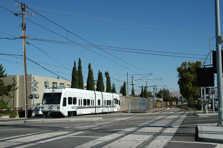 (139k, 720x478)<br><b>Country:</b> United States<br><b>City:</b> San Jose, CA<br><b>System:</b> Santa Clara VTA<br><b>Line:</b> VTA Vasona Line<br><b>Location:</b> Fruitdale <br><b>Car:</b> VTA Kinki-Sharyo 915 <br><b>Photo by:</b> Peter Ehrlich<br><b>Date:</b> 10/4/2005<br><b>Notes:</b> Approaching Fruitdale Station outbound.  The transition from single to double track is visible in the first image.<br><b>Viewed (this week/total):</b> 0 / 1459