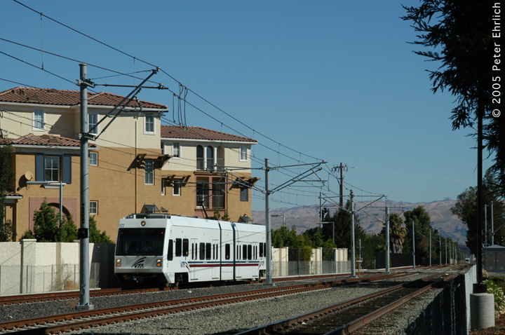 (150k, 720x478)<br><b>Country:</b> United States<br><b>City:</b> San Jose, CA<br><b>System:</b> Santa Clara VTA<br><b>Line:</b> VTA Vasona Line<br><b>Location:</b> Bascom <br><b>Car:</b> VTA Kinki-Sharyo 922 <br><b>Photo by:</b> Peter Ehrlich<br><b>Date:</b> 10/4/2005<br><b>Notes:</b> Approaching Bascom Station.  An inbound LRV is visible in the distance, at Fruitdale.  Meets between inbound and outbound trains are usually scheduled here.<br><b>Viewed (this week/total):</b> 0 / 1231