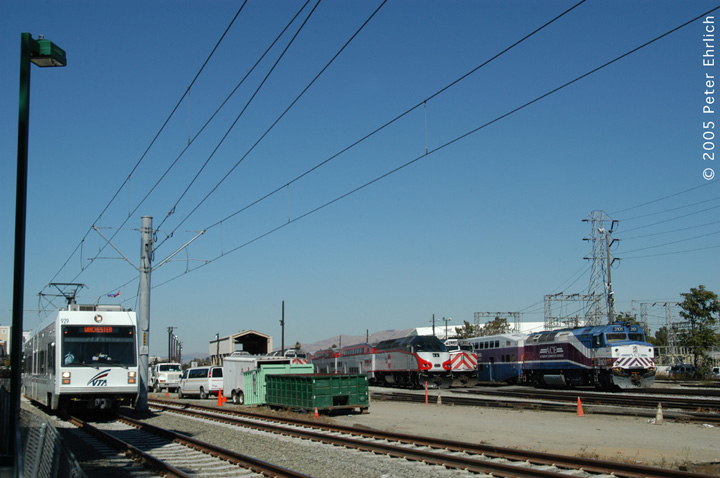 (119k, 720x478)<br><b>Country:</b> United States<br><b>City:</b> San Jose, CA<br><b>System:</b> Santa Clara VTA<br><b>Line:</b> VTA Vasona Line<br><b>Location:</b> San Jose Diridon <br><b>Car:</b> VTA Kinki-Sharyo 929 <br><b>Photo by:</b> Peter Ehrlich<br><b>Date:</b> 10/4/2005<br><b>Notes:</b> After leaving San Jose Diridon Station, cars pass the Caltrain engine depot.  Caltrain and Altamont Commuter Express locomotives are on the right.<br><b>Viewed (this week/total):</b> 0 / 1448