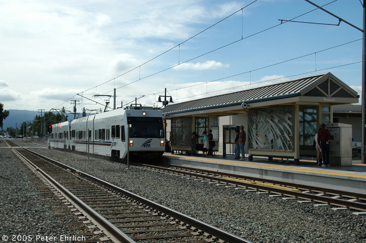 (163k, 720x478)<br><b>Country:</b> United States<br><b>City:</b> San Jose, CA<br><b>System:</b> Santa Clara VTA<br><b>Line:</b> VTA Vasona Line<br><b>Location:</b> Bascom <br><b>Car:</b> VTA Kinki-Sharyo 999+998 <br><b>Photo by:</b> Peter Ehrlich<br><b>Date:</b> 10/1/2005<br><b>Notes:</b> 999+998 arriving Bascom Station inbound.<br><b>Viewed (this week/total):</b> 0 / 1249