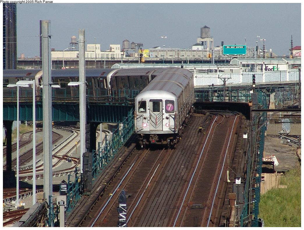 (248k, 1044x788)<br><b>Country:</b> United States<br><b>City:</b> New York<br><b>System:</b> New York City Transit<br><b>Line:</b> IRT Flushing Line<br><b>Location:</b> Viaduct approach east of Hunterspoint Ave. <br><b>Route:</b> 7<br><b>Car:</b> R-62A (Bombardier, 1984-1987)  1666 <br><b>Photo by:</b> Richard Panse<br><b>Date:</b> 10/3/2005<br><b>Notes:</b> View east from street.<br><b>Viewed (this week/total):</b> 1 / 3366